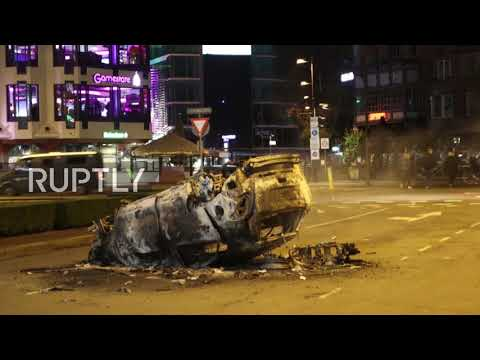 Netherlands: Damage and debris on Eindhoven streets in aftermath of anti-lockdown protest