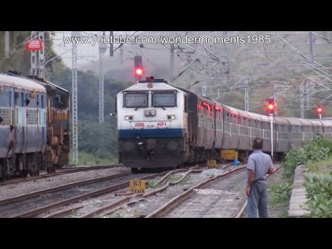 "Humming Beast with Coimbatore LTT ""Kurla"" express roars past Karnataka Sampark Kranti."