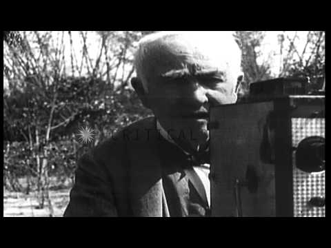 Thomas Edison operates a movie camera and films Henry Ford HD Stock Footage