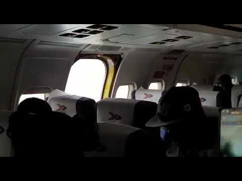 Passengers in Shock as Landing  Dana Air Emergency Door Flips Open