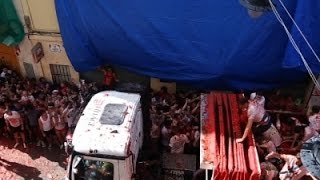 Raw: Spanish Streets Turn Red From Tomato Fight
