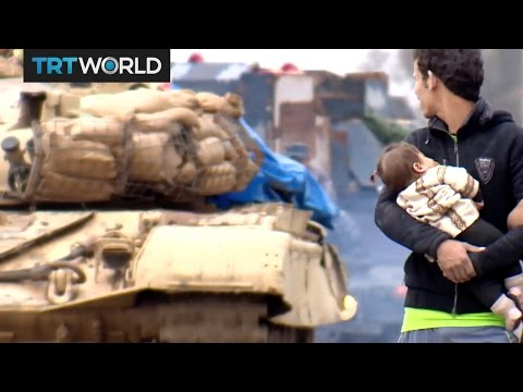 The Fight for Mosul: Civilians flee Mosul during torrential downpour