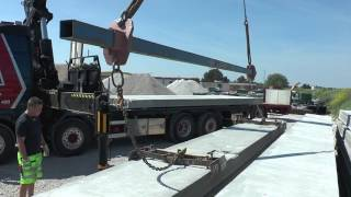 Volvo truck with a crane used for heavy lifting of concrete elements to a building outside the city