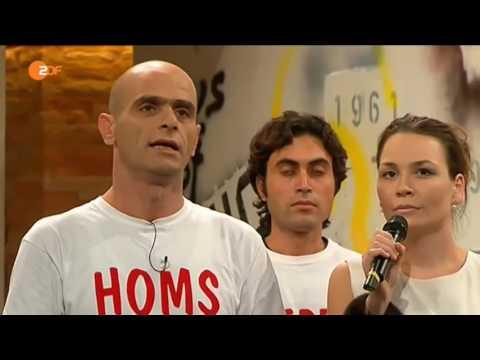 "Heartbreaking performance from a refugee choir | German TV show ""Die Anstalt"""