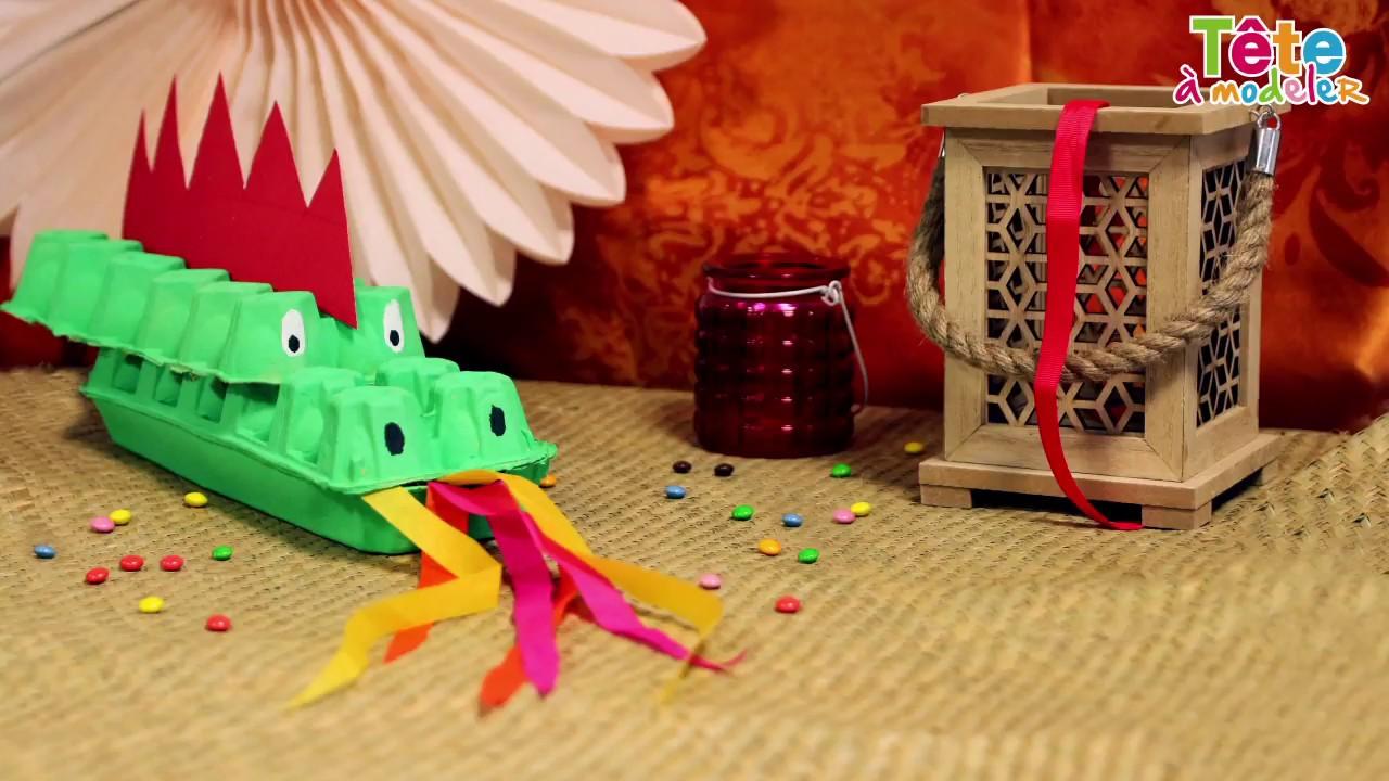 Tuto dragon en bo te d 39 oeufs une vid o by t te - Comment dessiner un dragon chinois ...