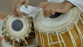 Closeup shot of a man playing the tabla drums - Indian Classical Music