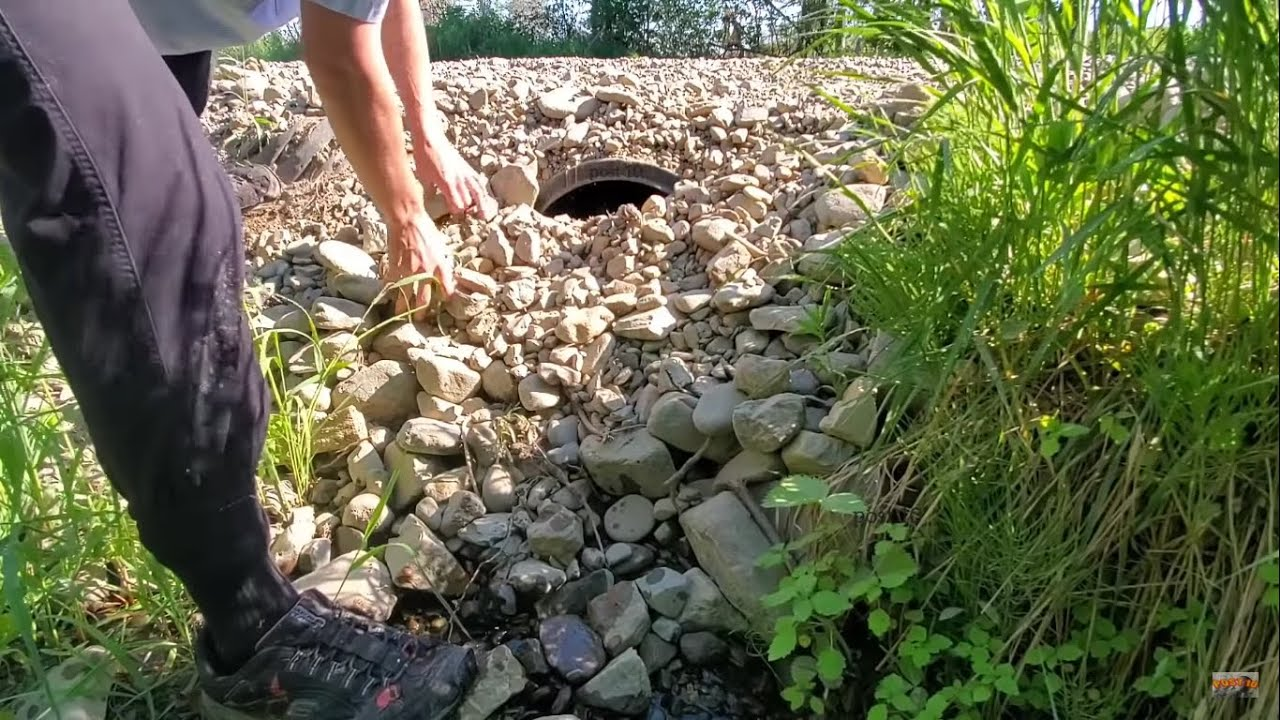 Unclogging Culvert, Draining Water, Sealed Shut By Wall Of Gravel