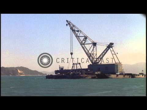 Crane lifts a Landing Craft Mechanized from a barge to repair another in Cam Ranh...HD Stock Footage