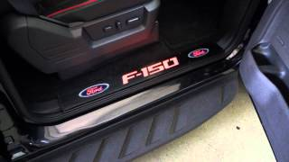 RECON Part # 264321FDBKRD Ford 09-14 F-150 Door Sill Black Finish - F150 & Ford Logo in RED LED