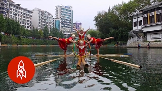 Women Dancing On Water On A Single Bamboo Show Insane Balance Skills