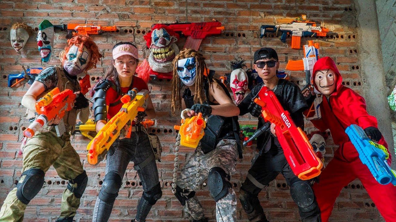 MASK Nerf War : Couple Warrior ALPHA Girl Nerf Guns Fight Mask Criminals Group King's Man