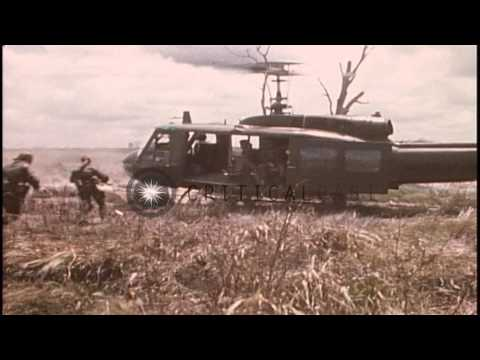 United States 50th Infantry soldiers fire at enemy in bushy area HD Stock Footage