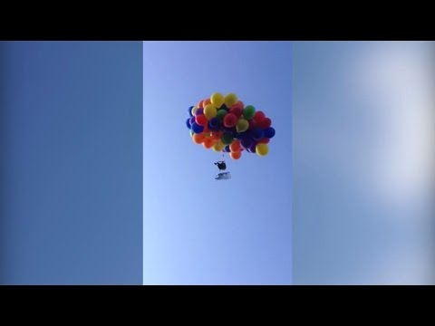 Daredevil Canadian man flies on a plastic chair tied with 100 helium balloons, arrested