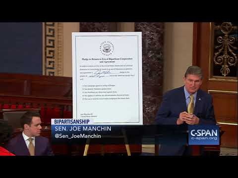 """Sen. Manchin (D-WV) signs """"Pledge to Return to Era of Bipartisan Cooperation and Agreement"""" (C-SPAN)"""