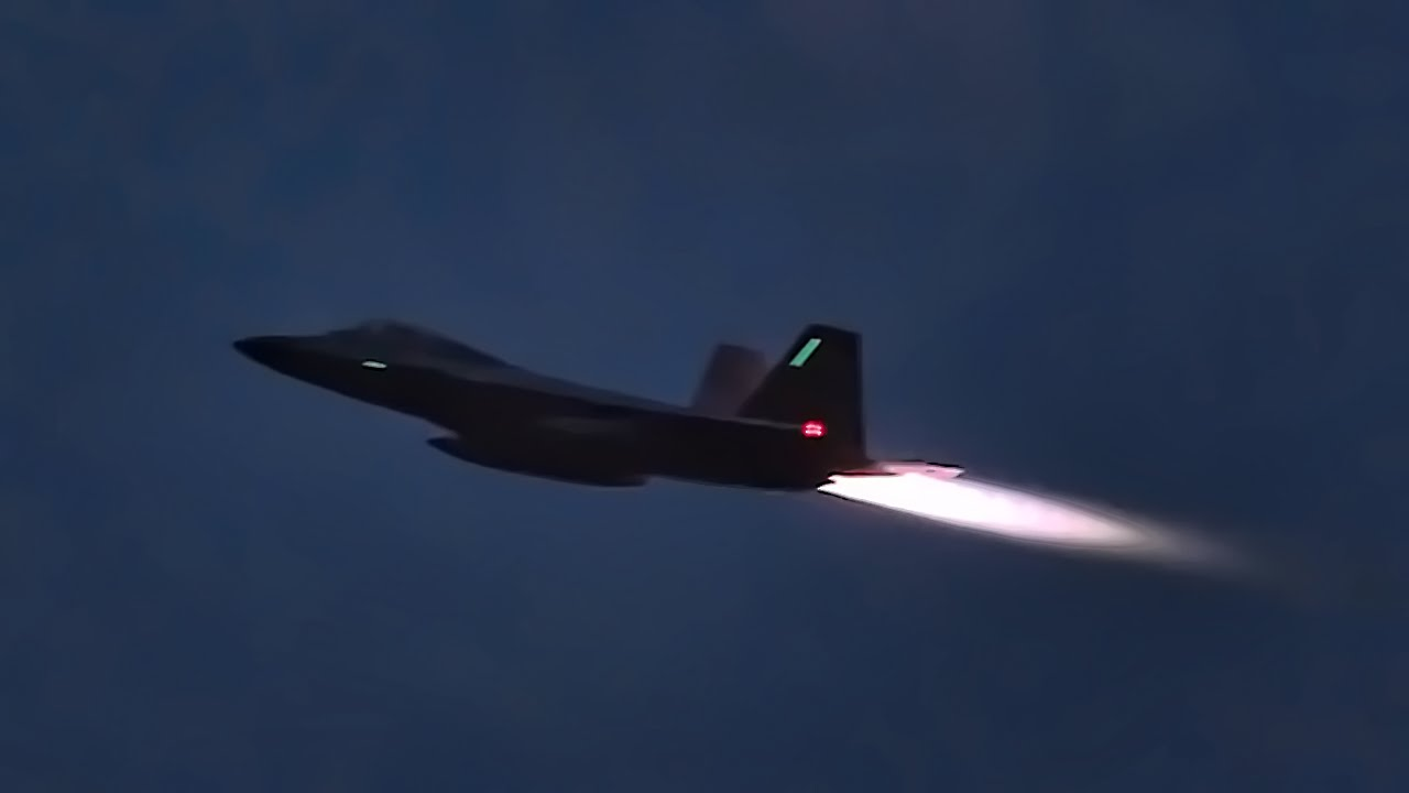 F-22 Raptors Takeoff At Night With Afterburners Glowing