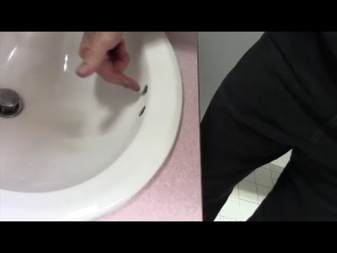 sink smells bad remove odor from overflow hole clean with enzyme cleaner
