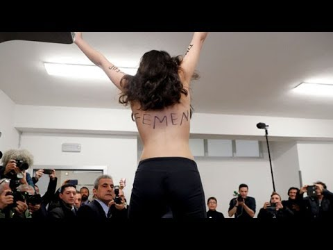 Italy election: Topless Femen activist disrupts Berlusconi's vote