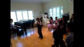The violin player is 8 years old (2nd grader), learning the violin ...