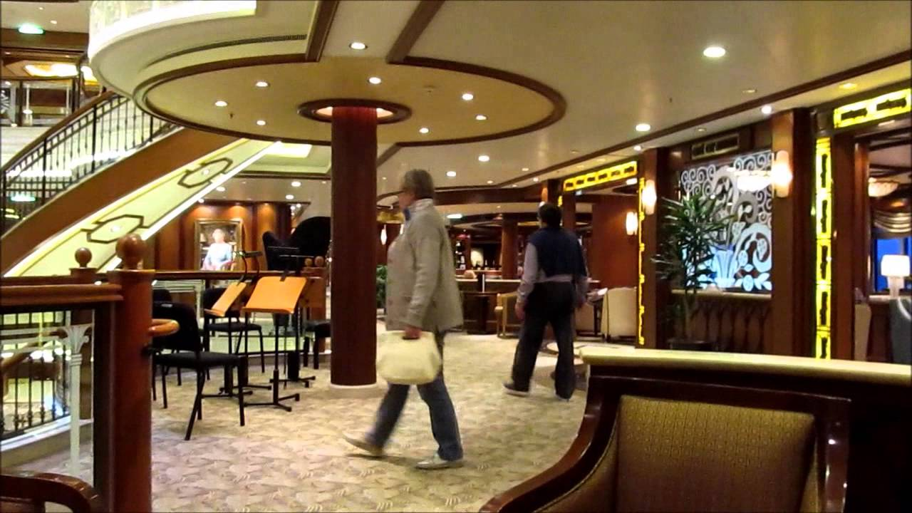 On board cunard 39 s ms queen elizabeth grand lobby queen elizabeth ii portrait cafe for Queen elizabeth 2 ship interior