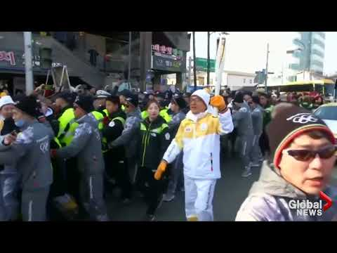 2018 Winter Olympics: Jackie Chan carries Olympic Torch