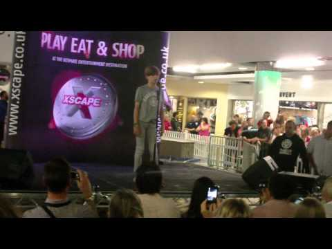 Ronan Parke performing the ending of Feeling good and then Make you feel my love live at Xscape 2011
