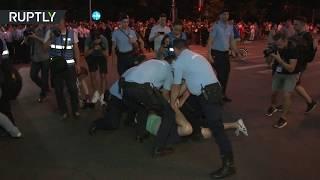 RAW: Police detain corruption protesters in Romania