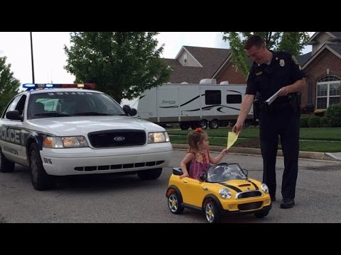 Cop Pulls Over 2 Year Old For Picking Her Nose While Driving Toy Car