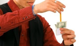 How to Do the Pencil through a Dollar Trick | Magic Tricks