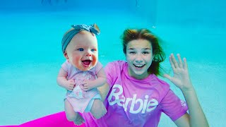 Maggie is swimming with baby Naomi in the swimming pool!