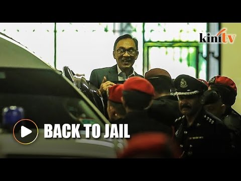 Anwar escorted back to prison after failing in bid to review jail sentence