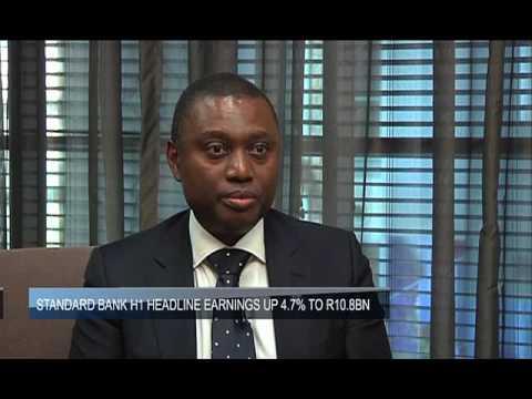 Standard Bank ups dividend despite profit drop