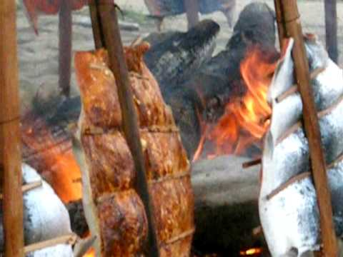 Makah Native Americans.  Salmon roasting.