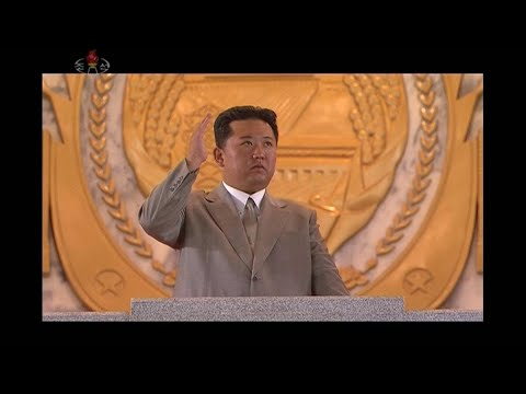 A Slimmer and More Tan Kim Jong Un Oversees Military Parade