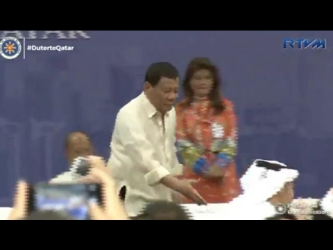 Duterte almost stumbles shaking hands with eager OFW