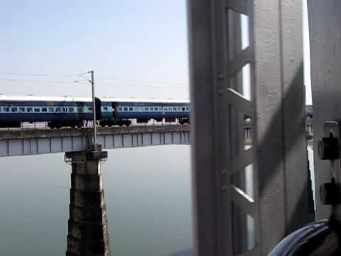 Indian Train passing through bridge on Narmada River Near Hoshangabad Madhya Pradesh