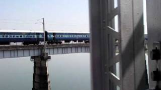 Indian Train passing through bridge on Narmada River Near Hoshangabad Madhya Pradesh
