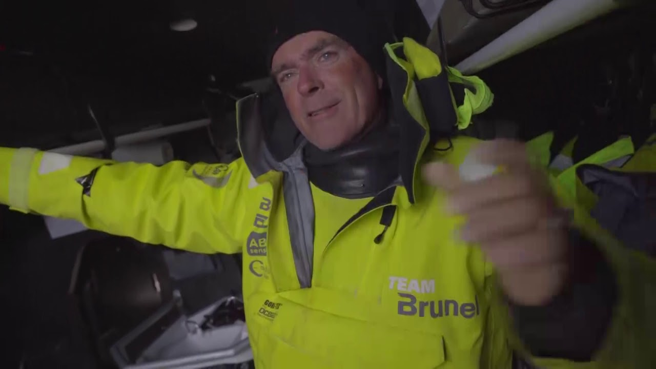 """Kyle, on the rail: Approaching Aarhus. Got Turn the Tide, AkzoNobel, and Scallywag behind us. Vestas ahead. MAPFRE and Dongfeng are quite a ways ahead; hoping for a parkup. Not the greatest position, probably 13-14 miles short of where we want to be. We're still confident we can come back in this leg. Pushing hard. Hopefully it will swing our way. Peter below lies down in his bunk. """"I'm for a nap."""" Sam: How we gonna get em, Pete? Peter: I don't know. Depends on the opportunities. Had a bit of a peeling frenzy this last hour: Masthead to J0 to Masthead to J1 to J0. We can see Vestas again. Hopefully the leaders are slowing up. Bouwe, below: So far it has been pretty much as predicted. Have done pretty well against Akzo and the boats behind us who have sailed in the same water. Sam: You're behind the red boats. Does that worry you, and how are you going to get them behind you? Bouwe: It worries me *shitless*. Because they have a really good lead, 11 miles dead upwind. If they turn the corner that 11 miles will be 25, 30 miles again. But luckily we go through the virtual waypoint. Chance of a parkup, and hopefully can catch them up. It will be difficult. After we come back past Denmark there's a lot of exclusion zones, traffic separation zones, wind farms; of coruse we're going to try to sail our own course. Might take a little bit of a flyer because we're relatively far behind. High pressure pushing in, so there's a chance for a buffalo girls sail the outside. So let's cross our fingers that's happening."""