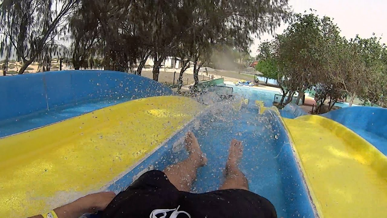 blue and yellow water slide at dreamland