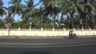 Driving a car on National Highway 8 & then turning off & passing Sisodra, Navsari, Gujarat, India; 23rd May 2012