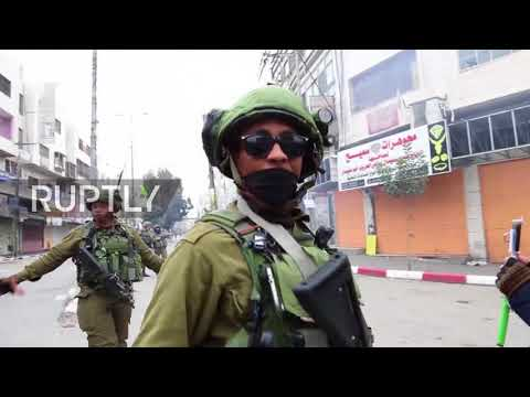 State of Palestine: Tear gas flies as Israeli forces clash with Hebron protesters