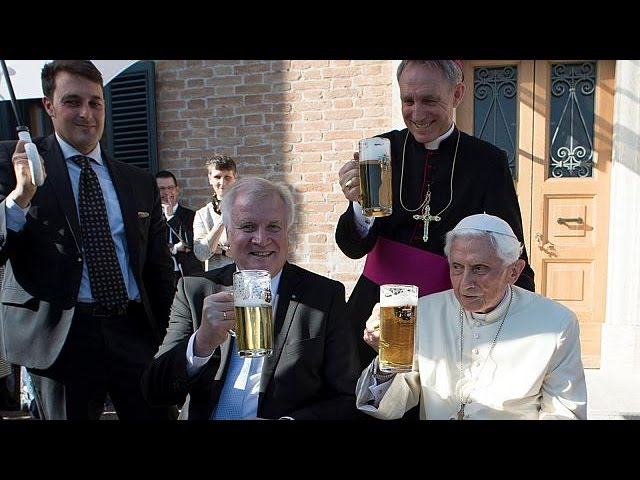 Pope Benedict XVI toasts his 90th birthday with a pint