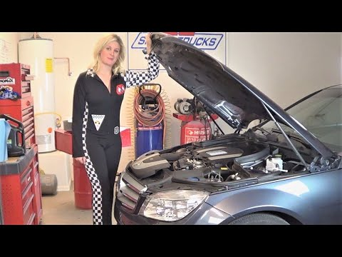 Beautiful Lauren Changing Engine Oil On A 2009 Mercedes Benz C300 At Howstuffinmycarworks
