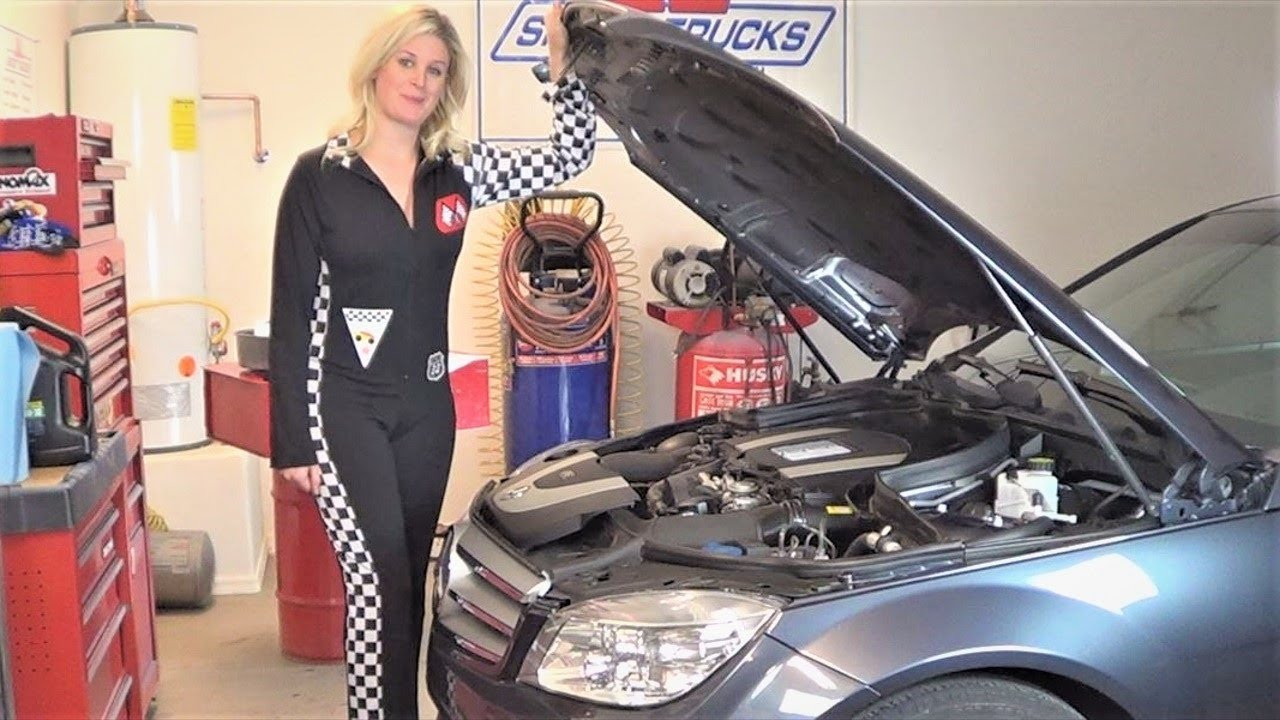 Beautiful lauren changing engine oil on a 2009 mercedes for Mercedes benz s550 oil change