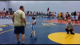 Screaming son causes wrestler dad to CHARGE mat and spray ref - BAD decisions pt. 2
