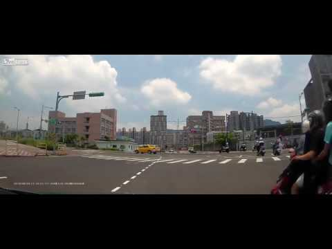 Dashcam: Taiwan ambulance runs red light, hits scooter