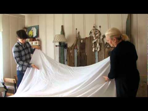 How To Make A Bed With A Flat Smooth White Linen Sheet