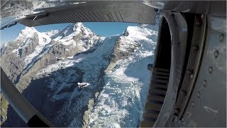Stunning! Wingsuit jumpers fly into plane in mid-air