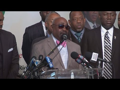 Terence Crutcher's father, Rev. Joey Crutcher with Al Sharpton speaks about his son