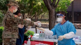 Fears grow over second wave of coronavirus as cases top 2 million in the United States