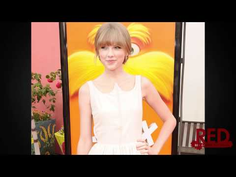Taylor Swift Dazzles in Honor at Lorax Premiere with Zac Efron